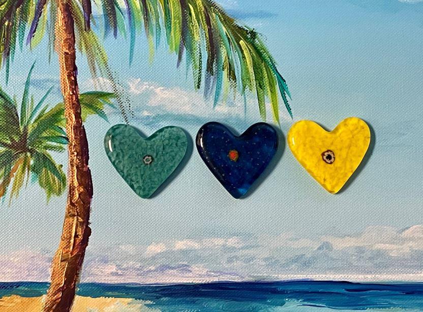 Scavenger Hunt Expansion - 3 Heart Sculptures over the Ocean